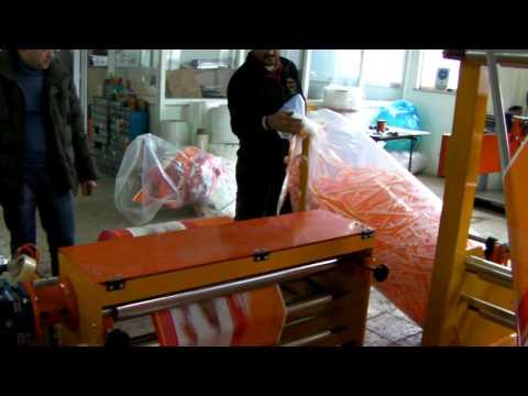 видео: Аппарат для складывания по полам со сворачивание в рулон ,пленка PE
