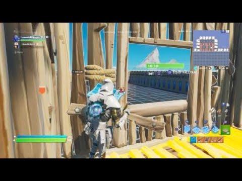Having a sniper battle in fortnite