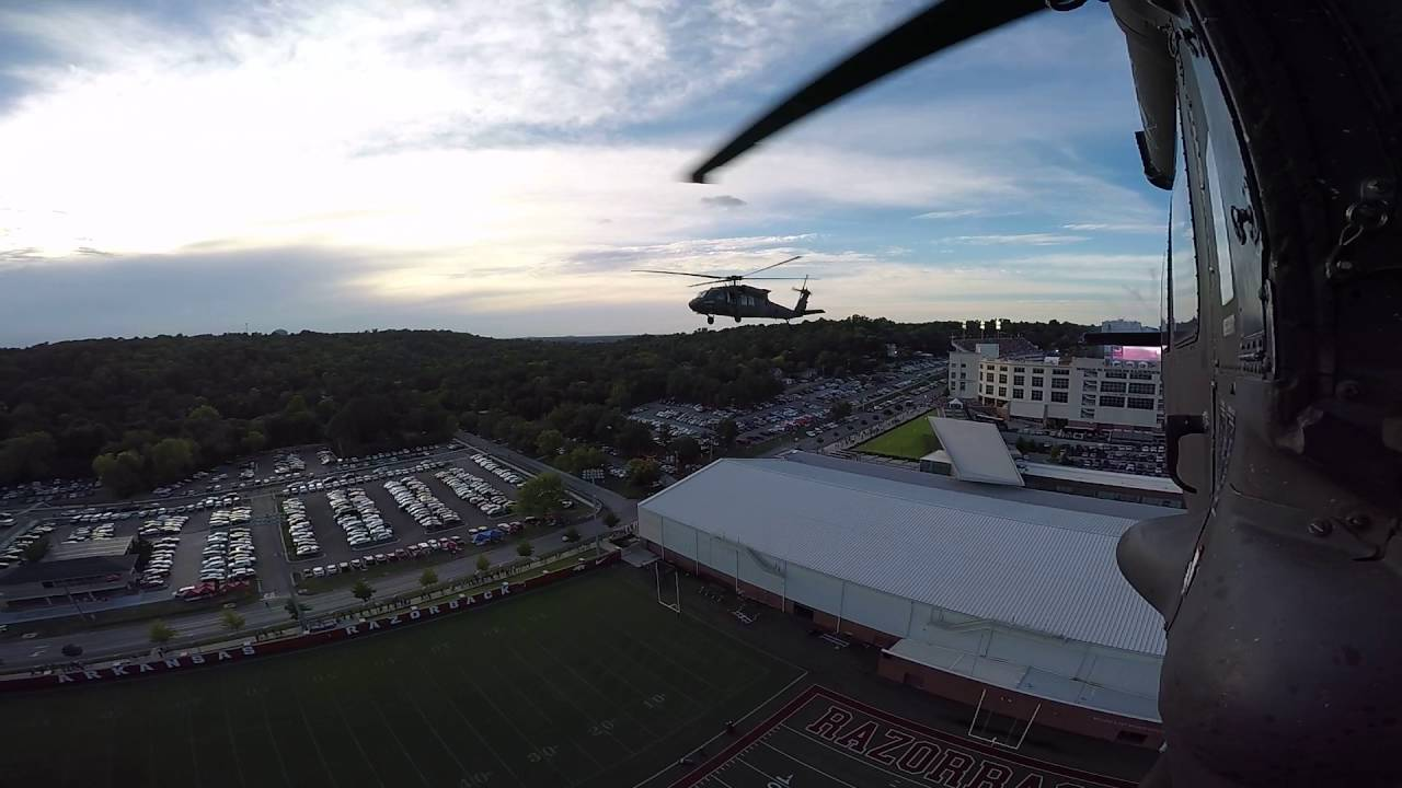 Two Arkansas Army National Guard UH-60 Black Hawk helicopters, piloted by members of the Arkansas National Guard's 77th Combat Aviation Brigade, fly in formation on Saturday, September 17, 2016, over Donald W. Reynolds Razorback Stadium in Fayetteville Ark. before the beginning of the University of Arkansas Razorbacks football game. The Razorbacks beat the Texas State Bobcats 42-3.