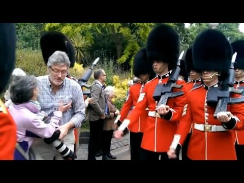 Queen's guards trample tourists