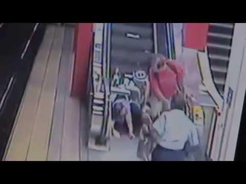 Woman In Wheelchair Falls Down Escalator Then Walks Down