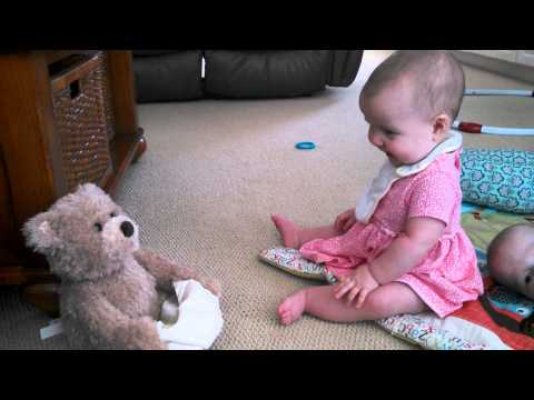 Playing with Peek-a-boo Bear (7 months)