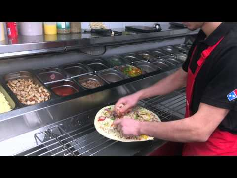 The making of a large BBQ Chicken Pizza