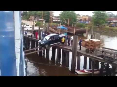 Jo Mercer - Brazilians Load a Truck on a Boat - Teeth Clencher