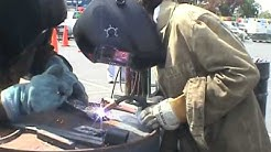 Kids welding at San Mateo Maker Faire 2008