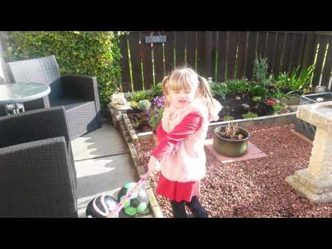 Frances helping grandad in garden.