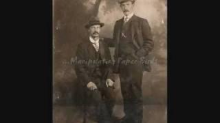 Strange Men in Pinstripe Suits
