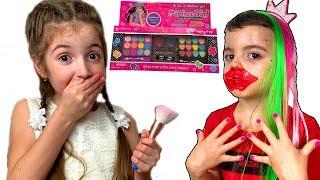 Vania and Masha play with makeup for girls