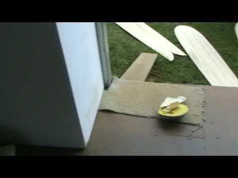 Alaia and hollow wooden surfboard by Chris Garrett