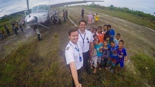 Repeat youtube video Susi Air: Landing at overgrown runway