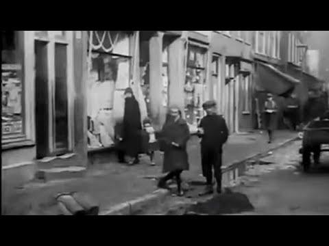 1926: De Willemsstraat in de Jordaan te Amsterdam voor & na asfaltering dat jaar - oude filmbeelden