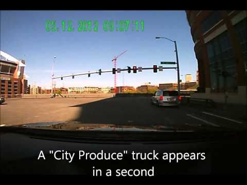 a Seattle City Produce truck never stops in front of the red light