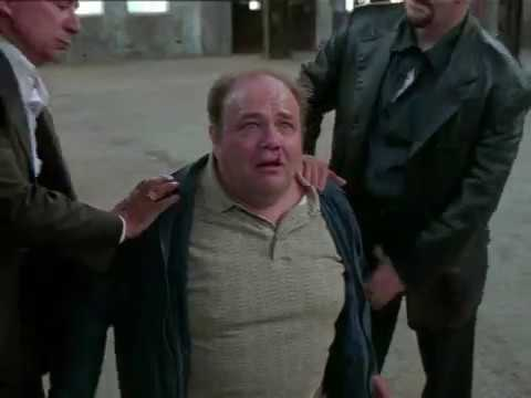 Why was the fat man forced to kneel down Was he in a gangdom