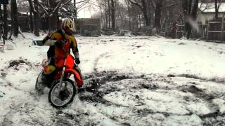 Honda cr 80 dirt bike ripping the snow and dirt