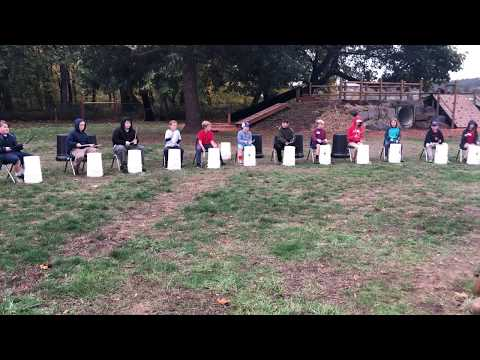 Molalla River Academy bucket drummers open Roots Day bonfire