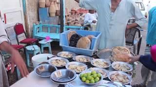 """بالفيديو.. عم هاشم صاحب أشهر طبق """"فول نابت"""" فى قنا"""