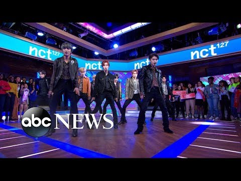 NCT 127 performs 'Cherry Bomb' and 'Superhuman' indir