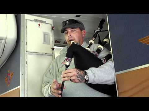 Palm Beach Firefighter plays bagpipes on jet
