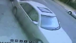 THIEF breaking car window to take  cell phone do not leave anything in your car