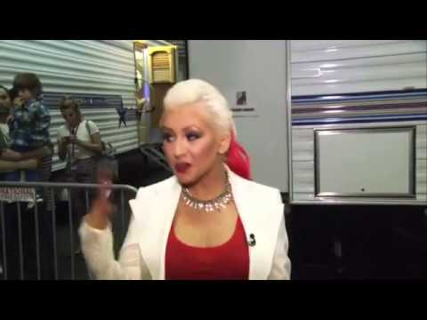 Christina Aguilera in a Tight Red Shirt and Lipstick Talks New Special