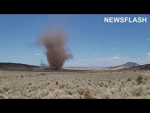 Large Dust Devil Skirts Across The Desert Floor