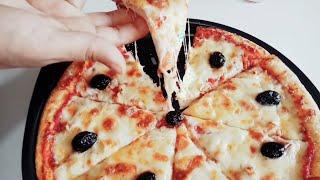 🍕بيتزا المطاعم بعجينة رائعة بدون دلك او مجهود 👌👌☝☝😊😊بمكون جديد يعطيها لذة وقرمشة