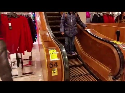 Vintage Otis wooden escalators at Macy's Herald Square