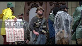 USA: Anti-lockdown protesters brave rain at Lansing demo