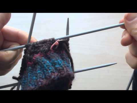 Knitting up close, counting, so many needles!