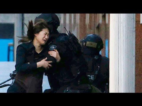 Women hostages flee Sydney siege café