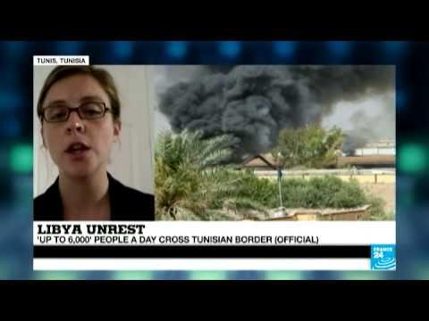Libya unrest - 6,000 people cross border into Tunisia daily