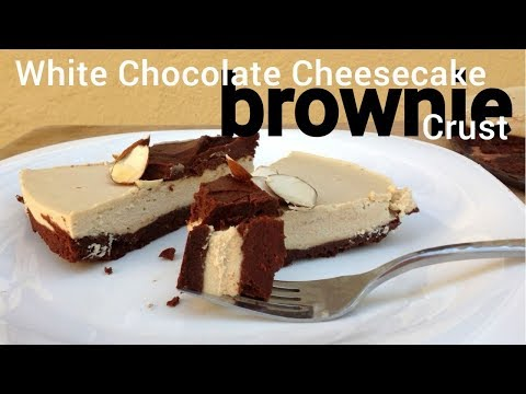 Luscious White Chocolate Cheesecake on a Fudgy Brownie Crust | A Rich and Decadent Vegan Dessert