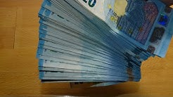 Counting stack of 20 EURO banknotes