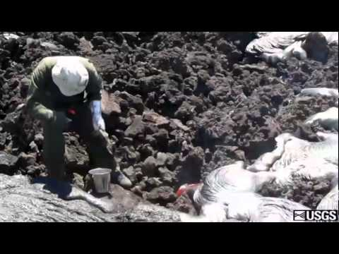 Geologist scoops molten Lava From Hawaii
