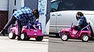 Woman Drives Toy Jeep on Main Roads to the Store