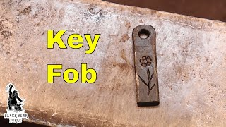Key fob with decorative stamp