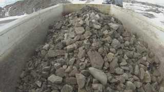 Dump truck hauling rock. GoPro practice stuff