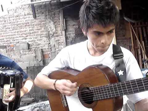 FRANCISCO ARIAS alumno de ORLANDO CARABAJAL  y cristaian  palacio en guitarra alumno de MIGUEL ARCE