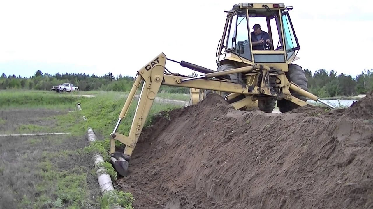 Caterpiller 416 Backhoe Ditching and Shaping Dikes