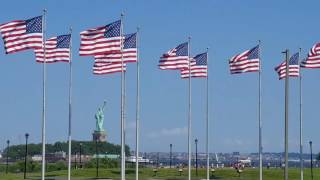 Flags in front of the Statue of Liberty