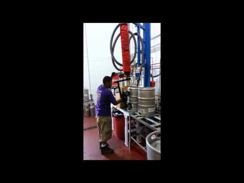 Conveyor Handling Company: Vacuum Keg Lifting & Rotating System