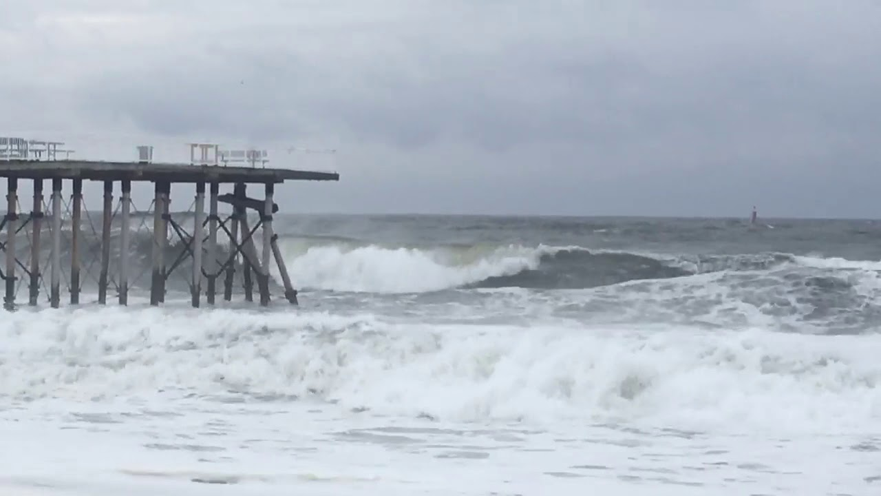 Waves crash against belmar fishing pier youtube for Fishing report belmar nj