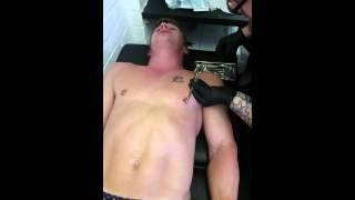 Jonesy gets nipple pierced...Such a brave boy!