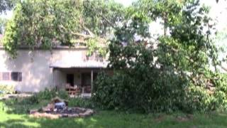 Cleaning Up: Storm Damaged House Under Repair