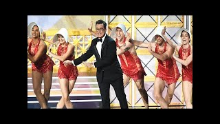 Stephen colbert opens the 2017 emmys with a jaunty tune, trump jokes, and … sean spicer