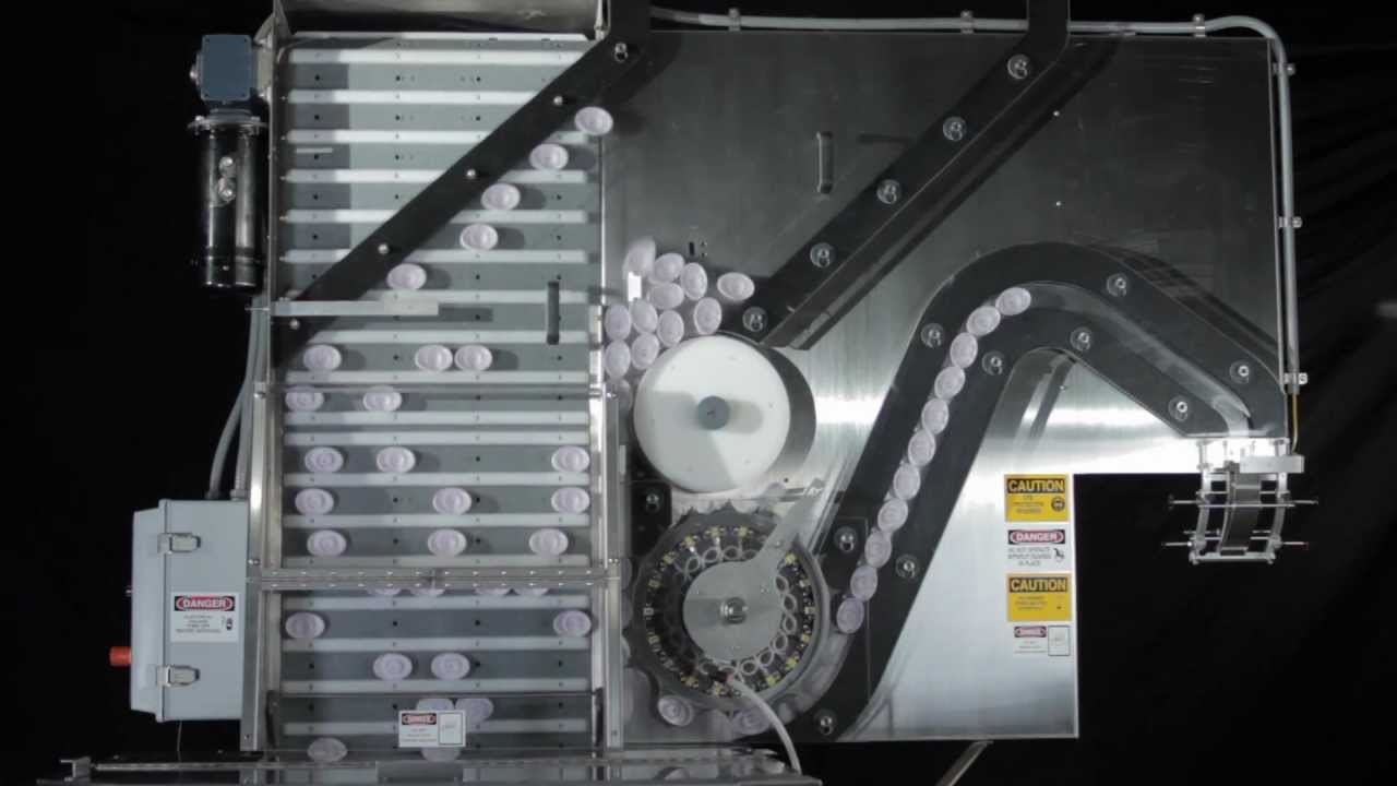 Pack West Machinery Cap Orienting System For Oval Caps