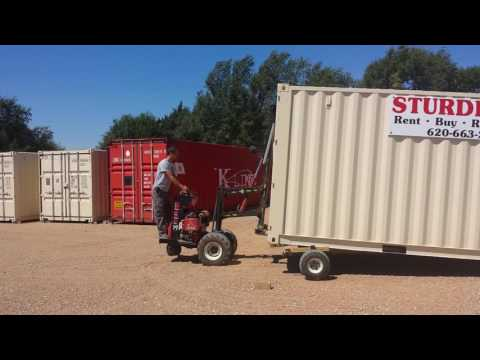 Sturdi-Bilt Storage Container Delivery With Mule At Sturdi-Bilt Storage Barns