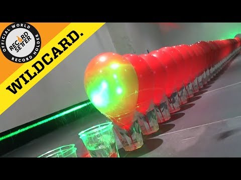 Most Balloons Popped Domino Style With A Laser