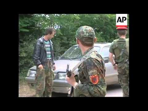 Yugoslavia: Kosovo: K-FOR Troops Disarm KLA Soldiers -  1999
