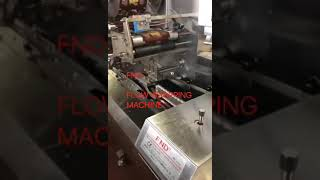 Flow wrapping machine for chocolate cake